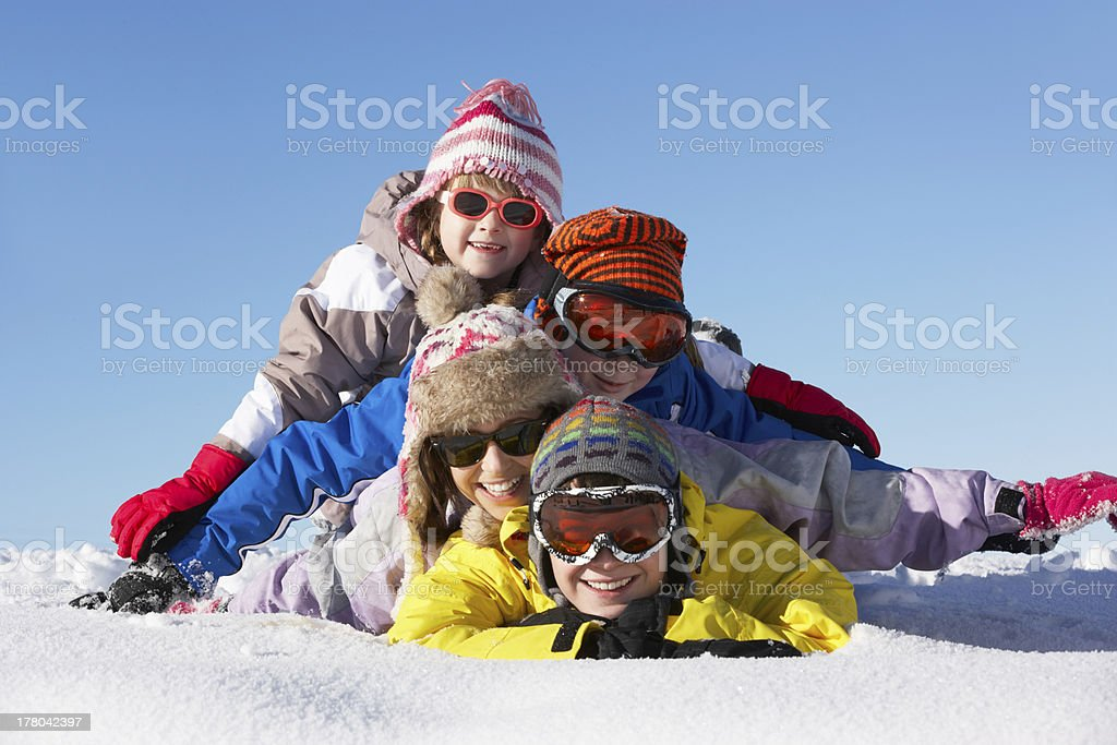 Group Of Children Having Fun On Ski Holiday In Mountains stock photo