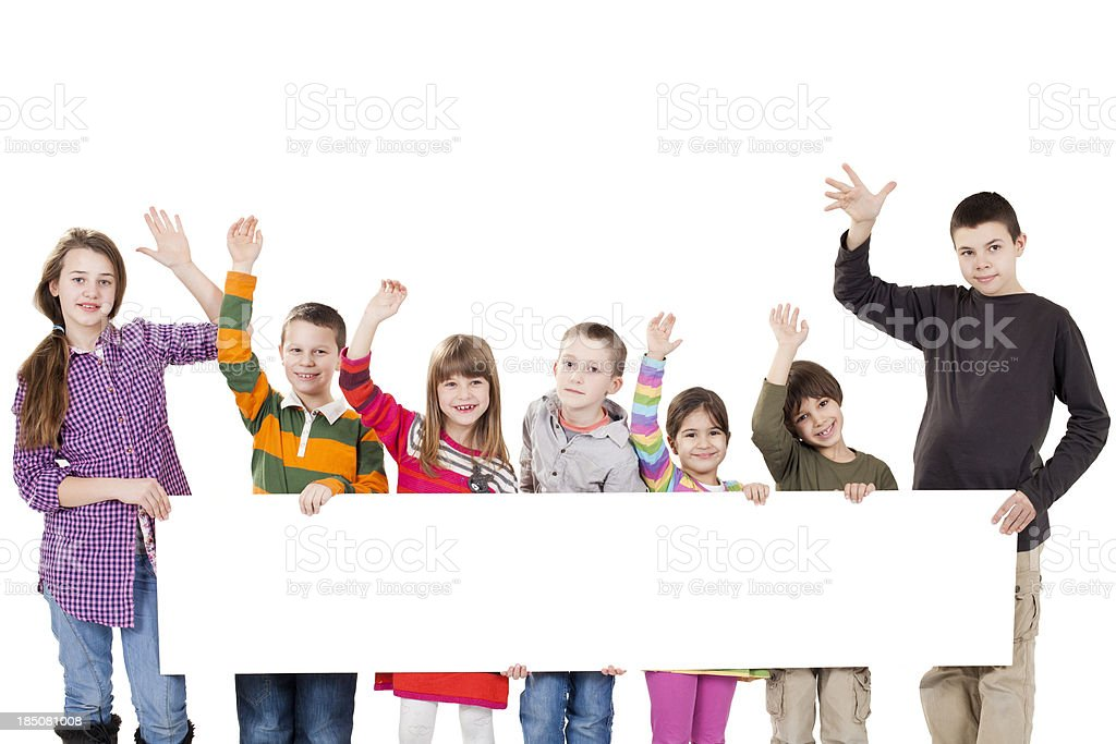 group of children holding a sign royalty-free stock photo