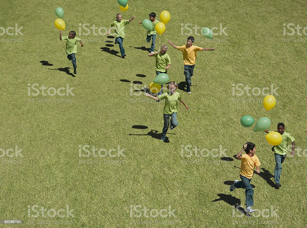Group of children holding balloons royalty-free stock photo