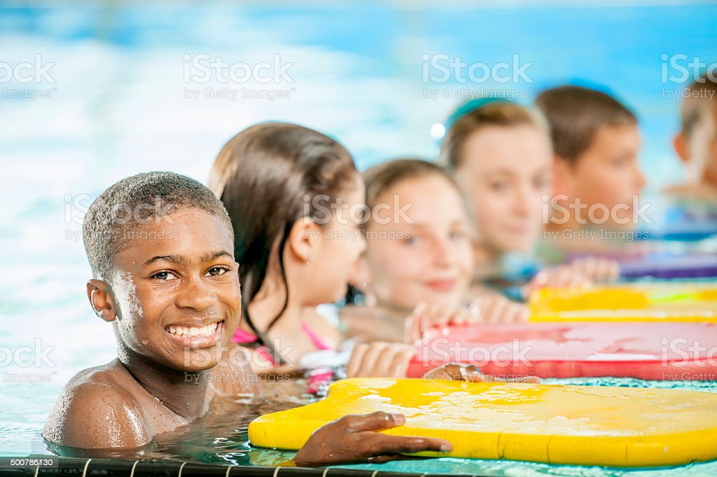 Group of Children in a Swimming Lesson stock photo