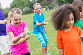 Group of children in egg spoon race