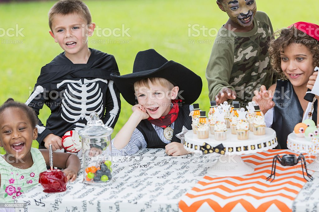 Group of children in halloween costumes at party stock photo