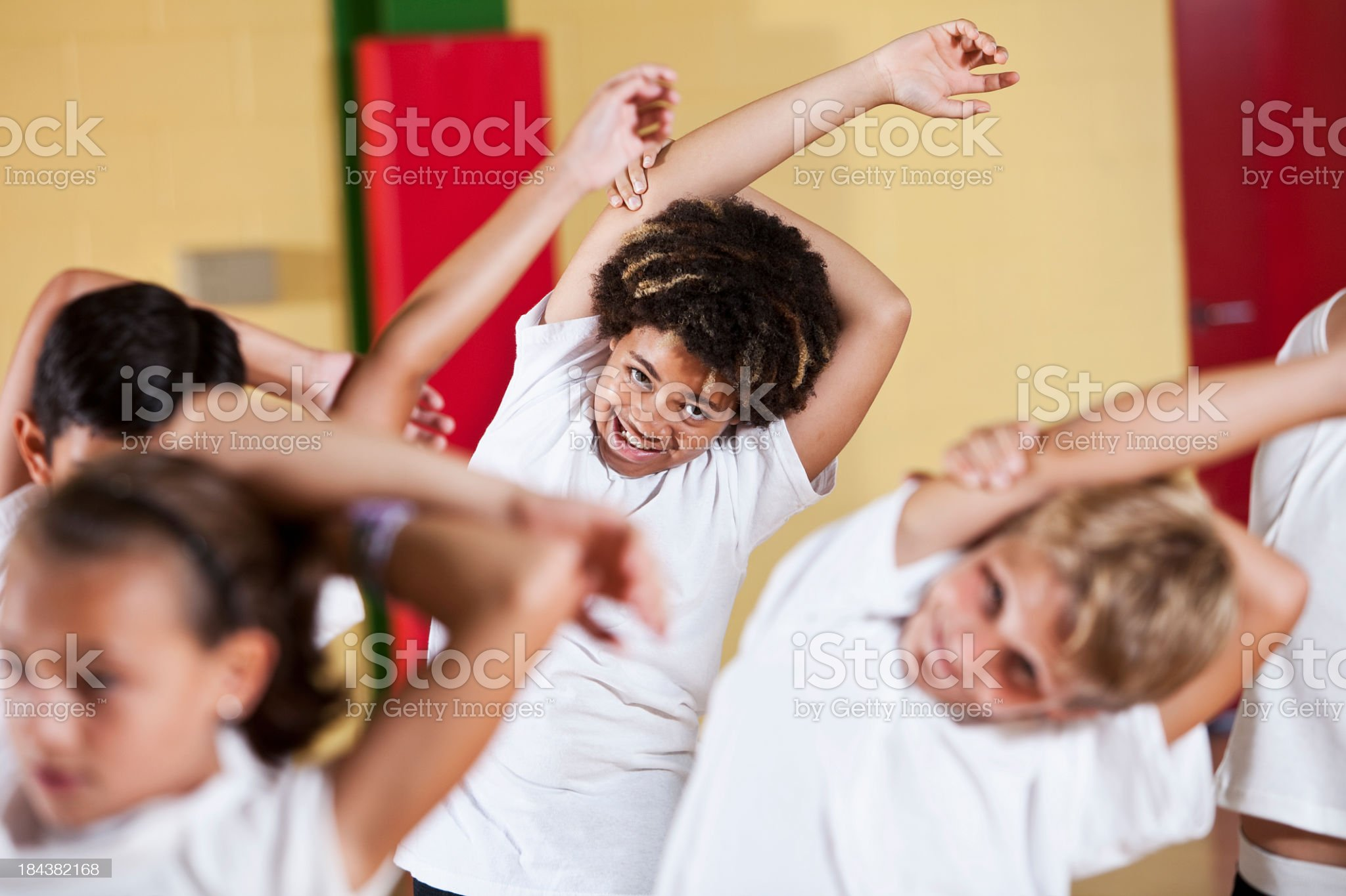 Group of children in phys ed class stretching royalty-free stock photo