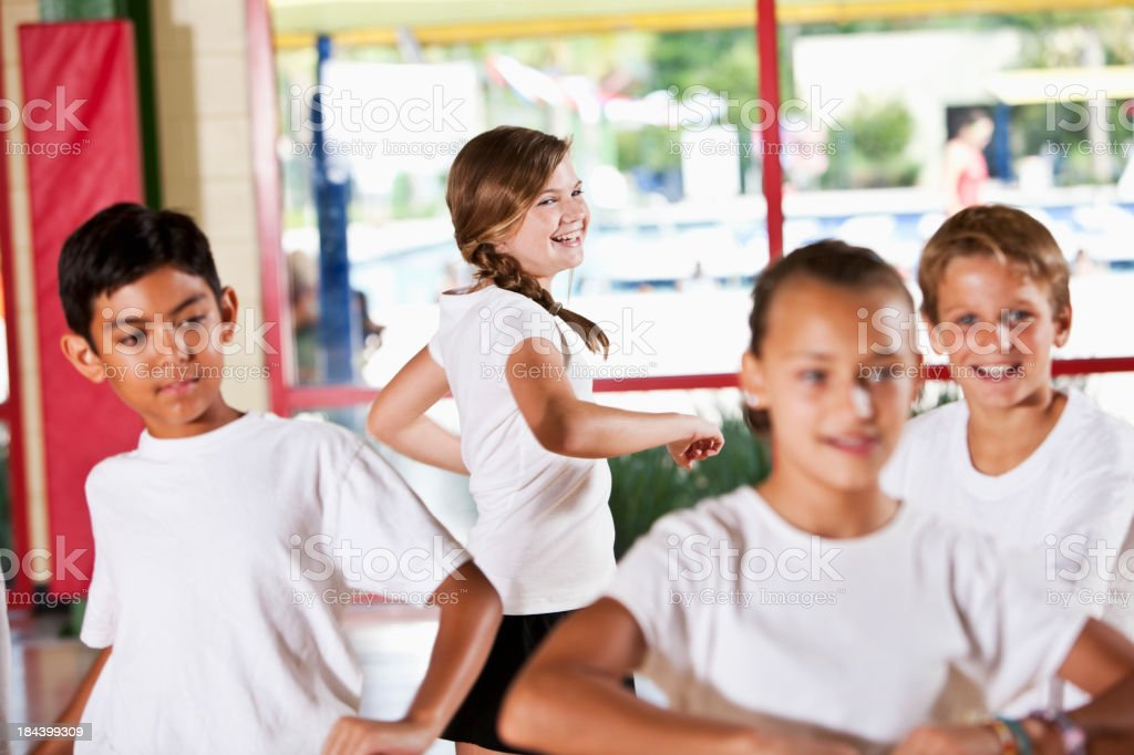 Group of children in phys ed class stretching stock photo