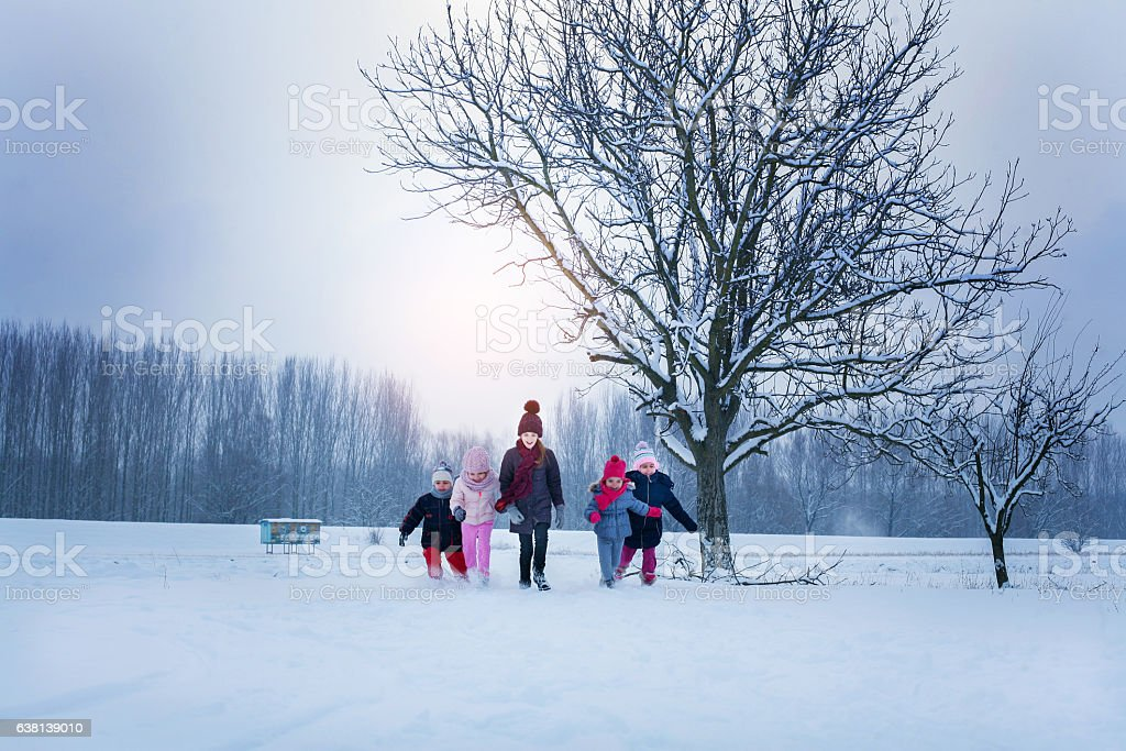 Group of children in the snow. stock photo