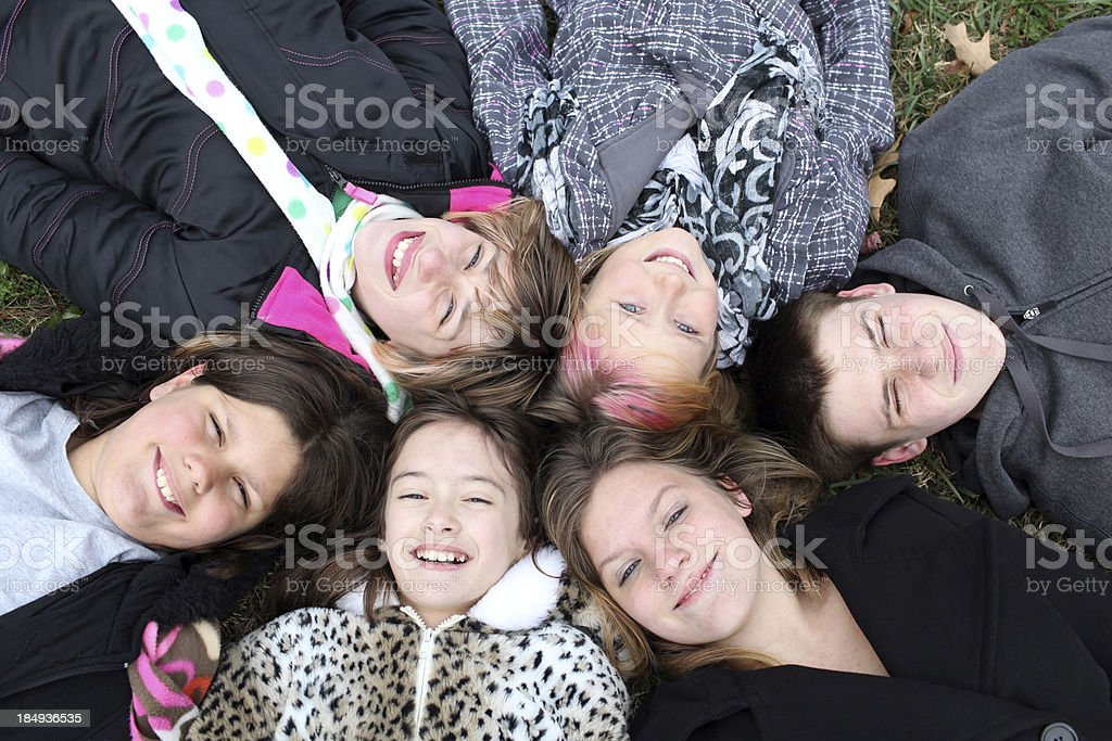 Group of children lying in a Circle stock photo