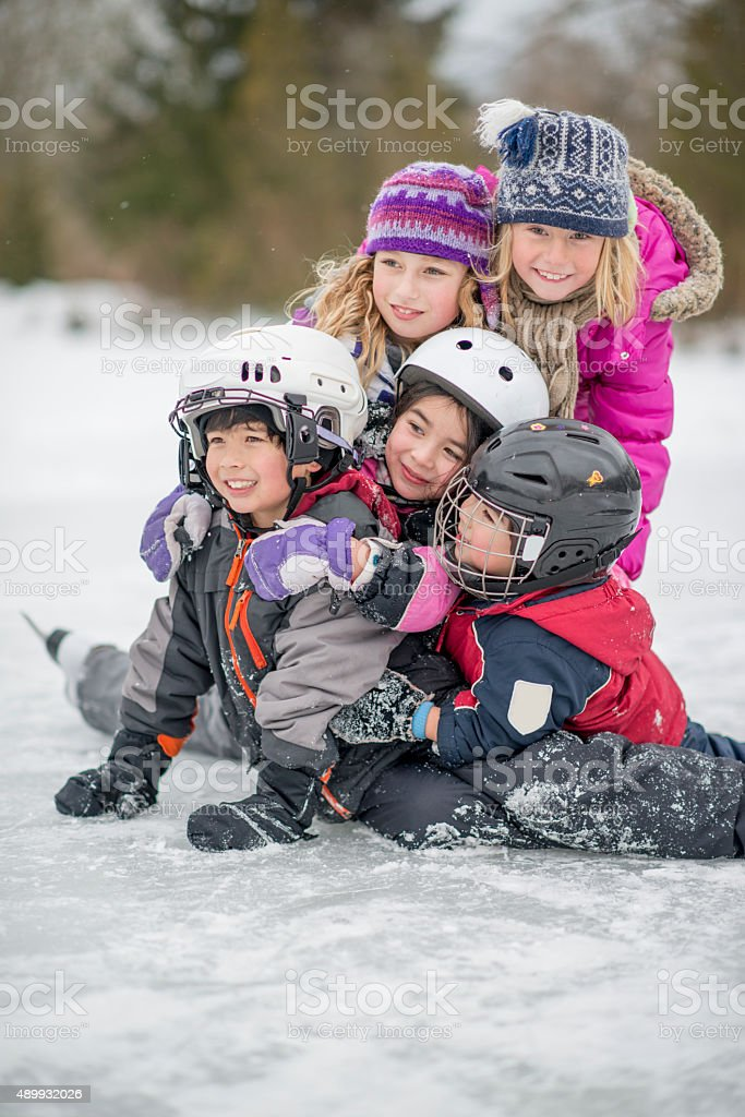 Group of Children on a Frozen Lake stock photo