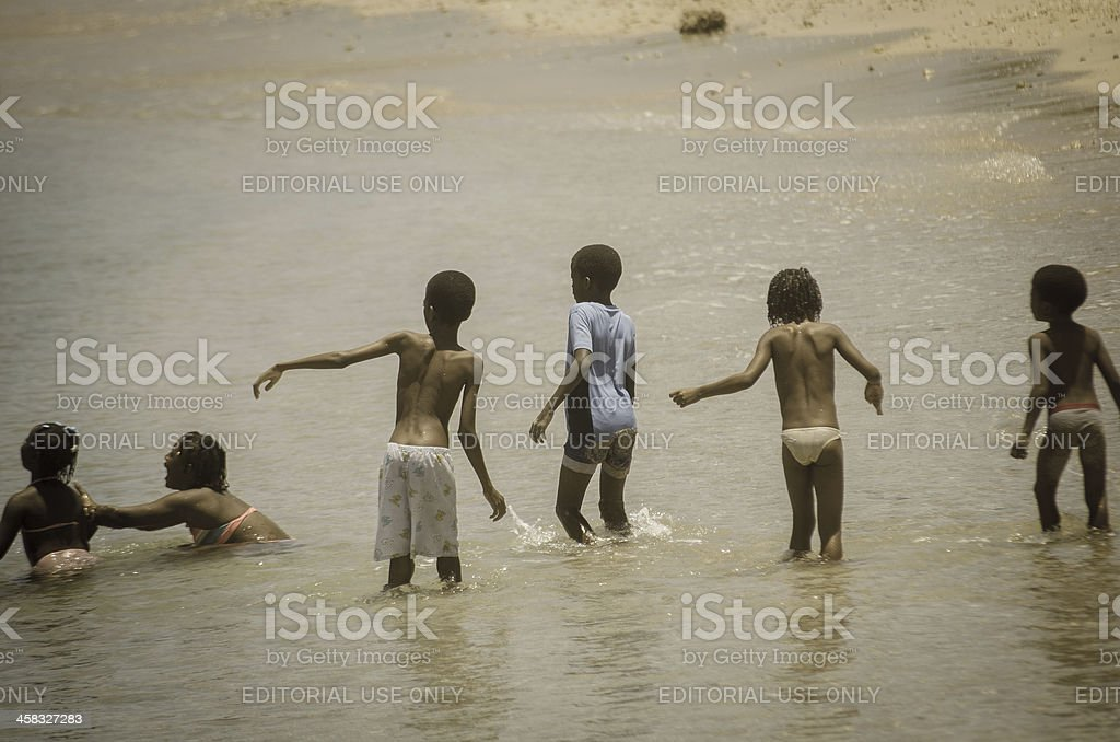Group of children on beach at Pigeon Point stock photo
