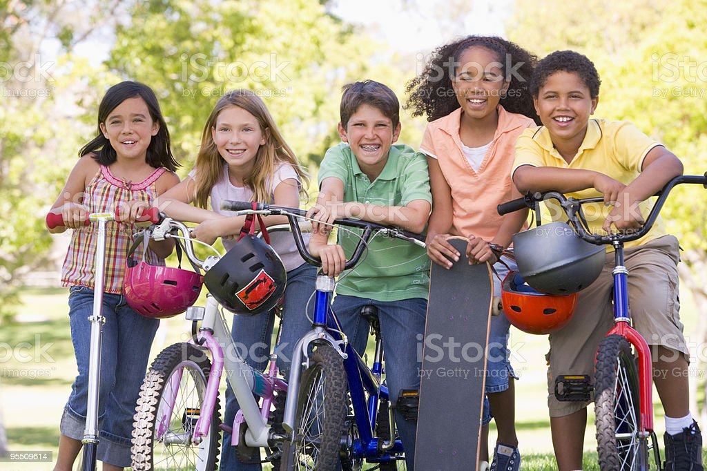 Group of children on bikes stock photo