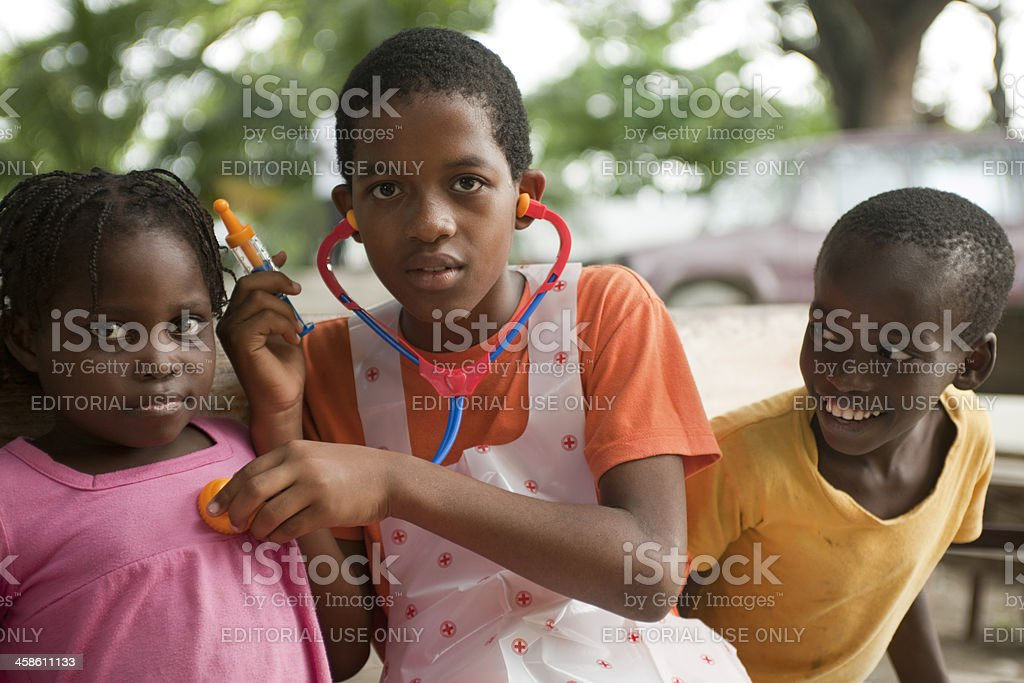 Group of children playing doctor stock photo