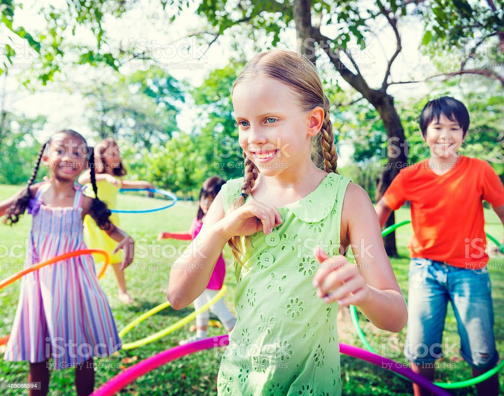 Group of Children Playing Hula Hoop Concept stock photo