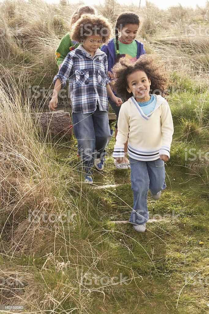 Group Of Children Playing In Field Together royalty-free stock photo