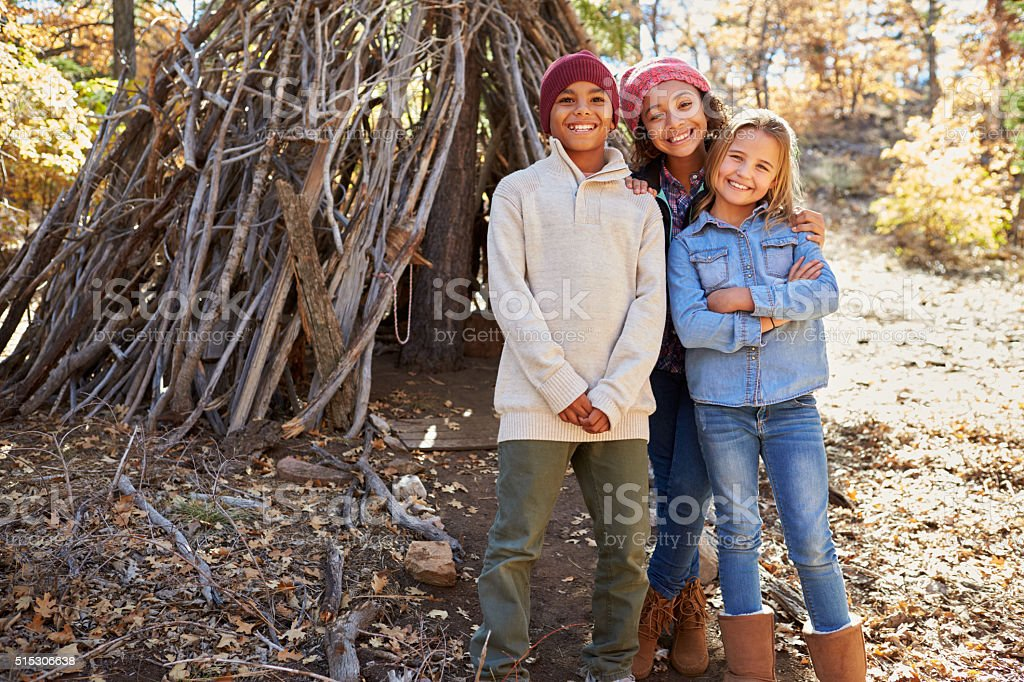 Group Of Children Playing In Forest Camp Together stock photo