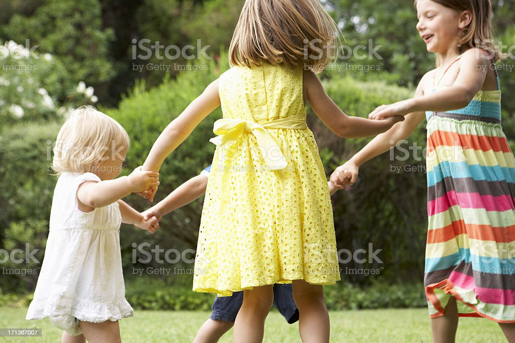 Group Of Children Playing Outdoors Together royalty-free stock photo