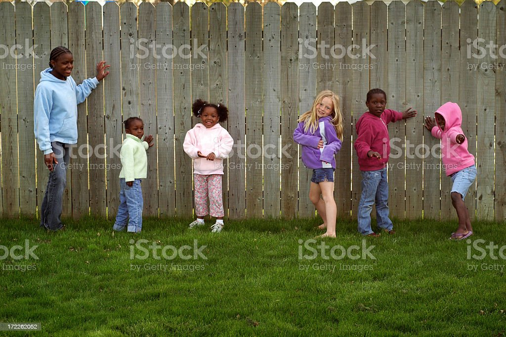 Group of Children Playing Together in the Back Yard royalty-free stock photo
