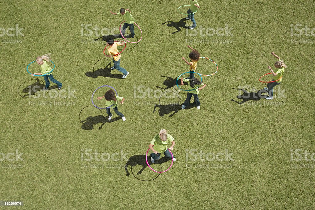 Group of children playing with hula hoops royalty-free stock photo