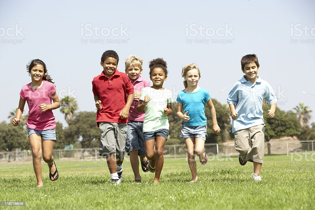 Group Of Children Running In Park stock photo