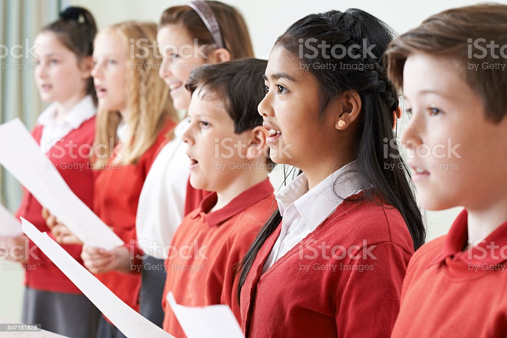 Group Of Children Singing In School Choir stock photo