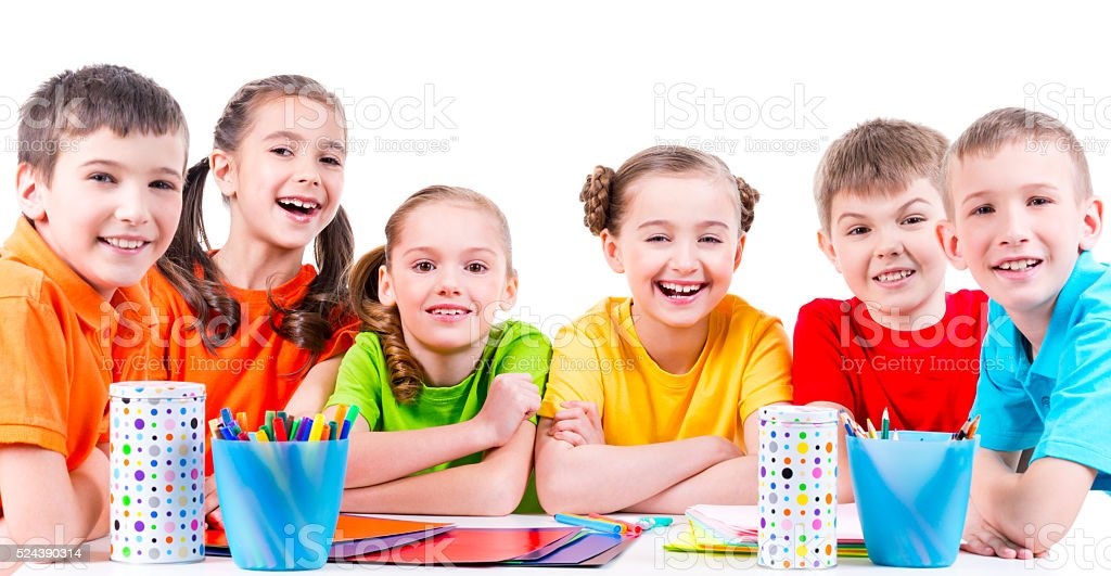 Group of children sitting at a table stock photo