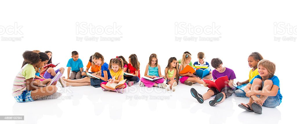 Group of children sitting on floor and learning together. stock photo