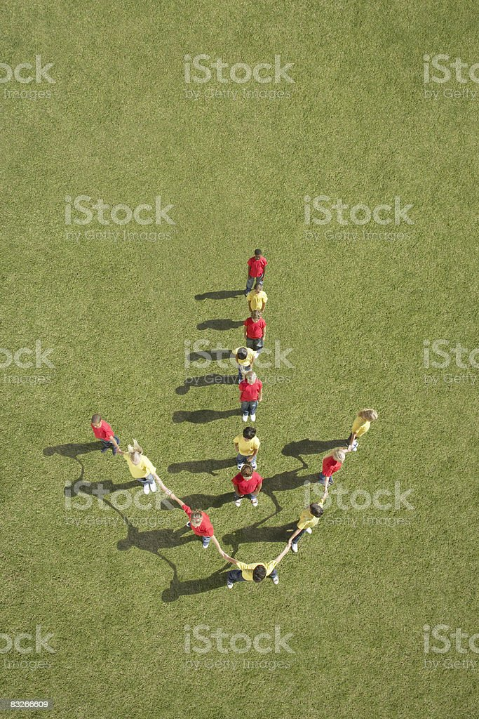 Group of children standing in arrow formation royalty-free stock photo