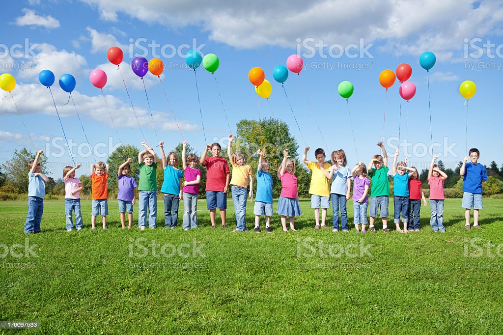Group of Children Standing in Line with Balloons royalty-free stock photo