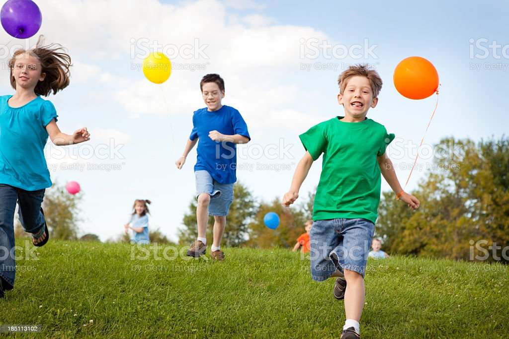 Group of Children Standing with Balloons, Color Image royalty-free stock photo