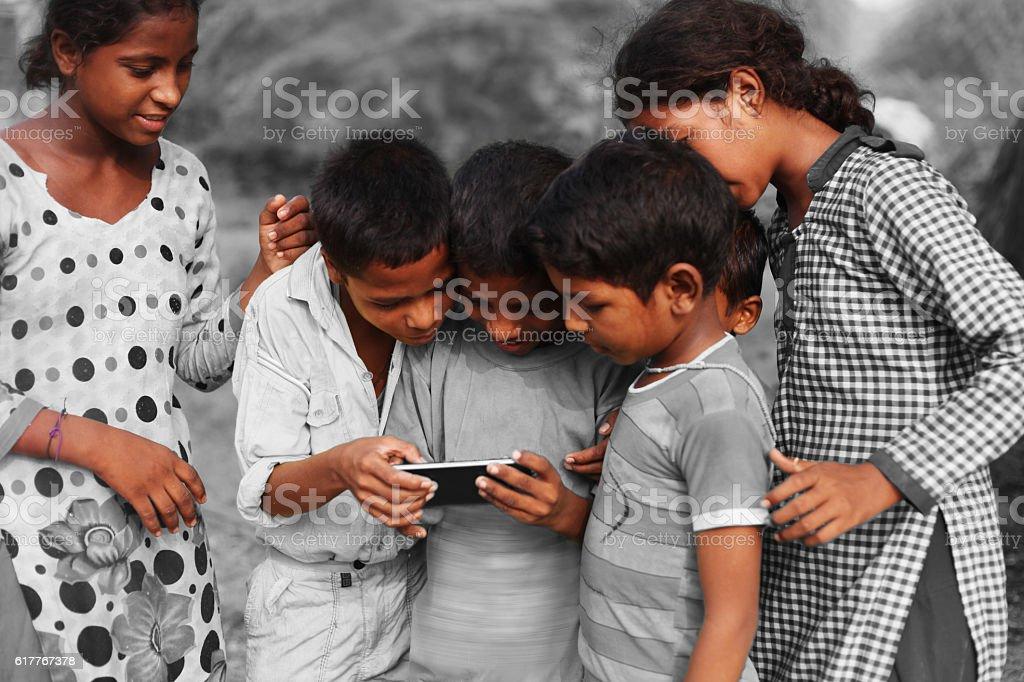 Group of children using smart phone stock photo
