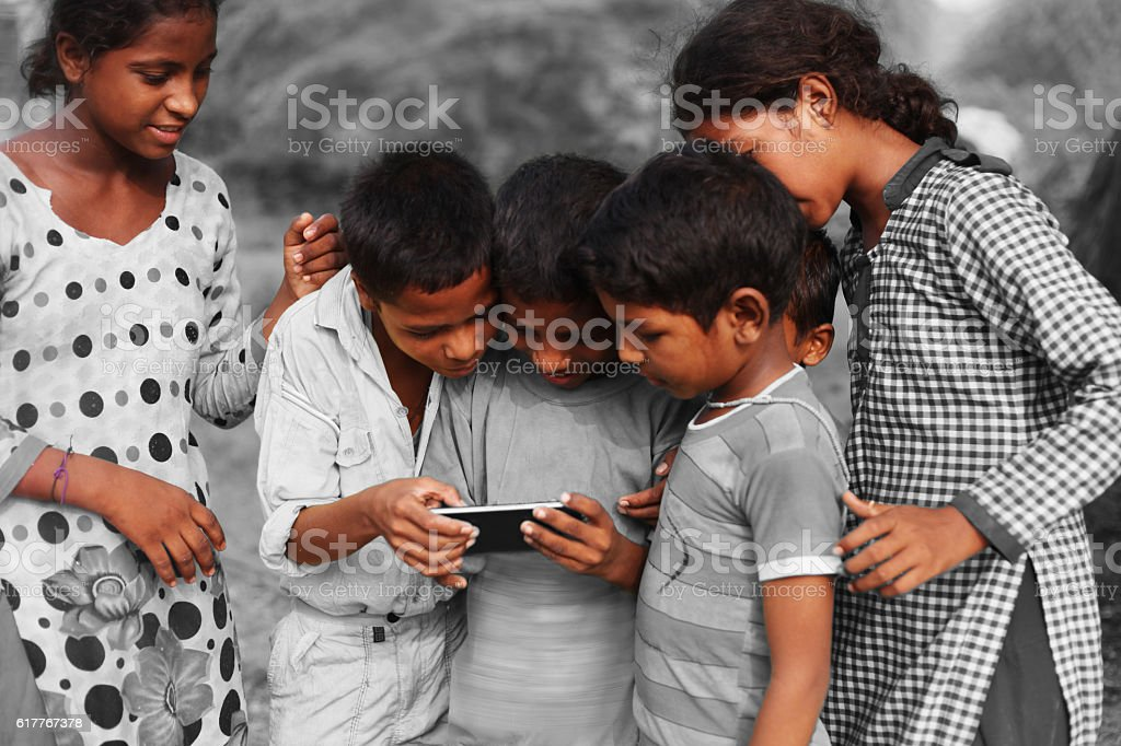Group of children using smart phone stock photo