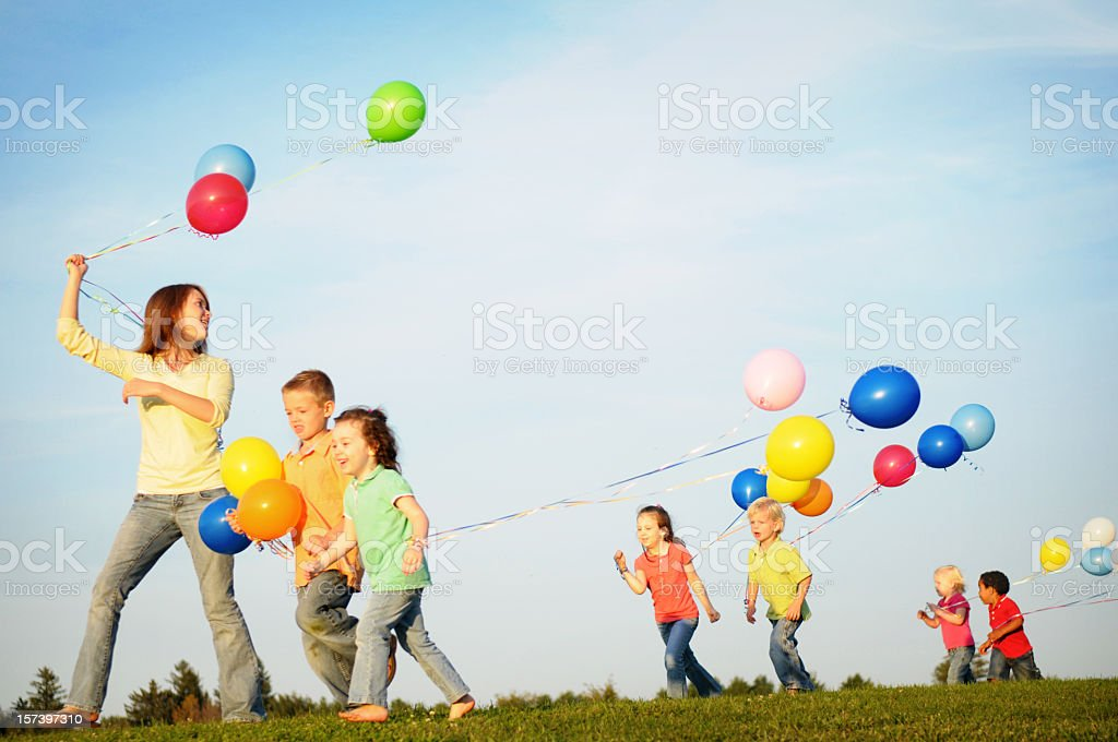 Group of Children Walking while Holding Balloons royalty-free stock photo