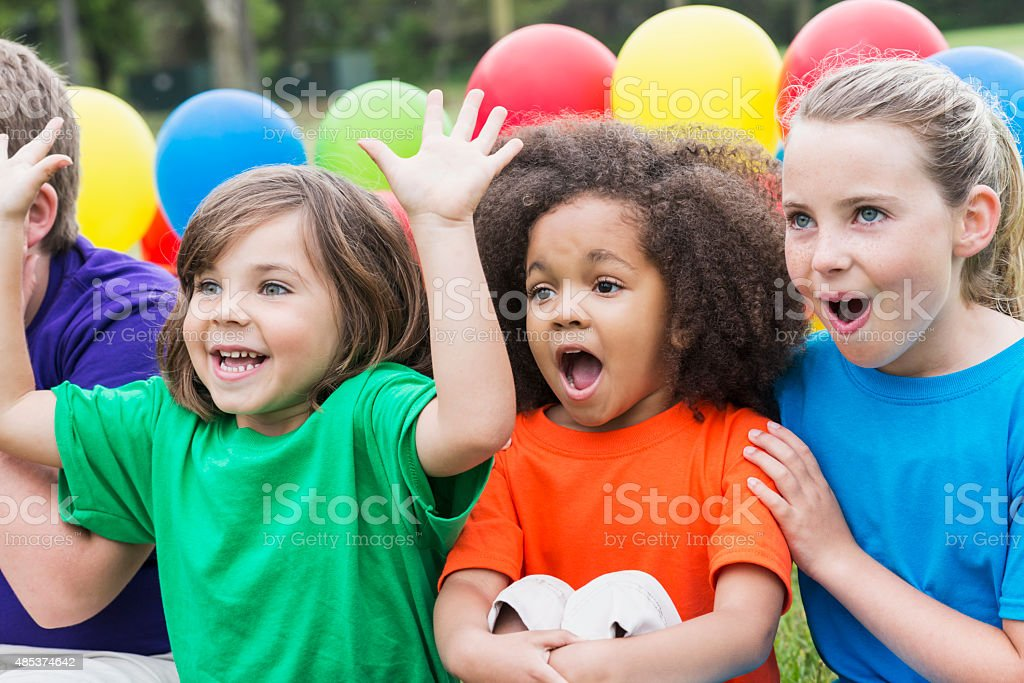 Group of children watching something amazing stock photo