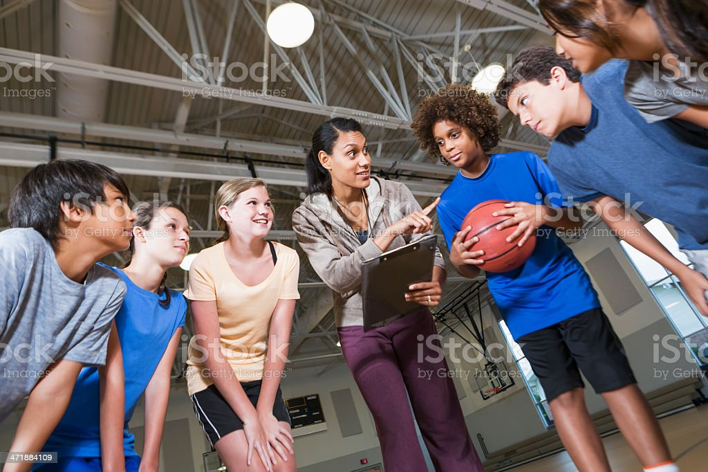 Group of children with basketball coach royalty-free stock photo