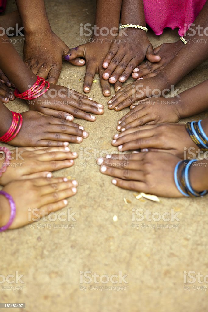 Group of children with hands together on the floor royalty-free stock photo