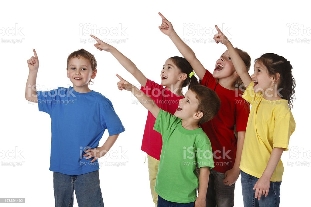 Group of children with pointing up sign stock photo