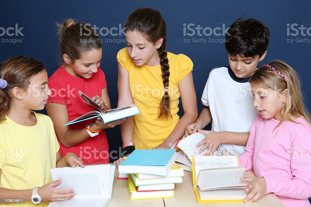 group of children with textbooks royalty-free stock photo