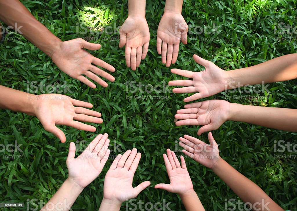 Group of children's hands, palms up, in a circle royalty-free stock photo