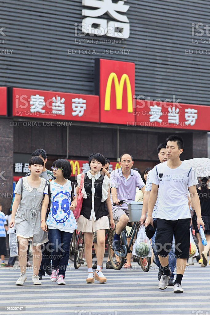 Group of Chinese teens near MacDonals outlet royalty-free stock photo