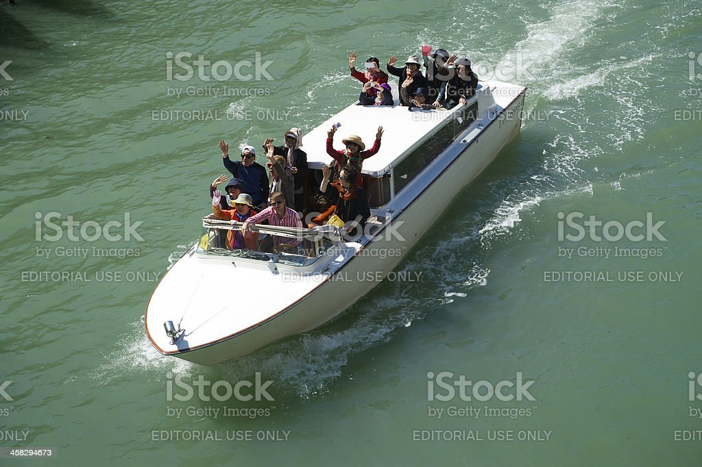 Group of Chinese Tourists Ride Boat Grand Canal Venice Italy royalty-free stock photo