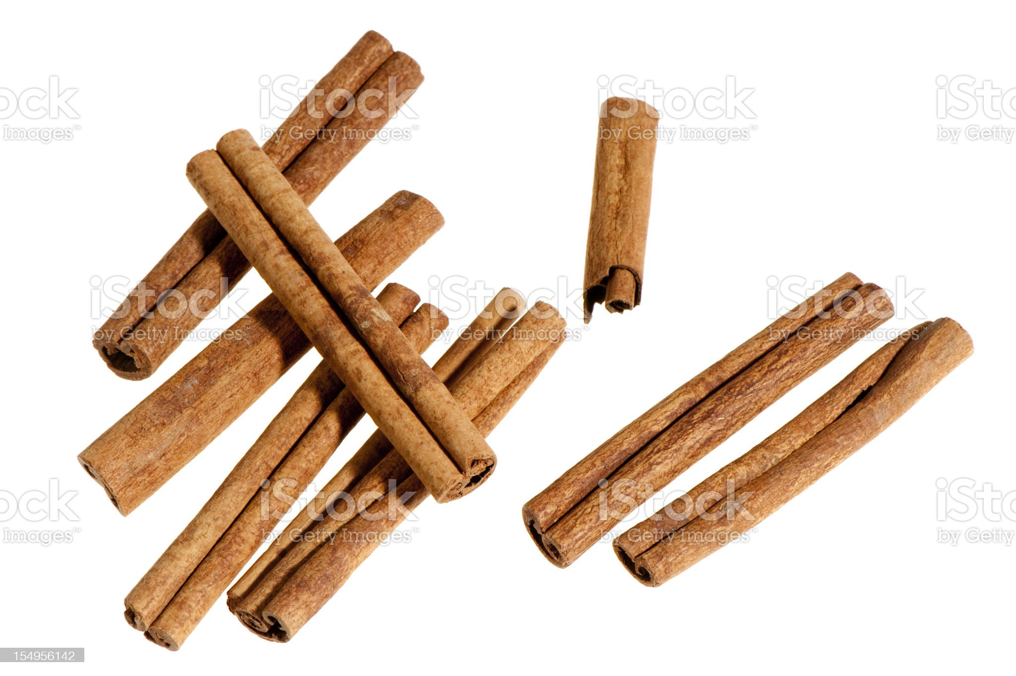 Group of cinnamon sticks on white background royalty-free stock photo