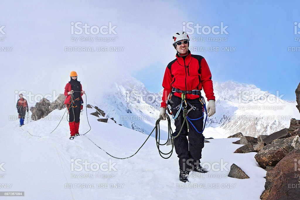 Group of climbers ascent to the mountain stock photo