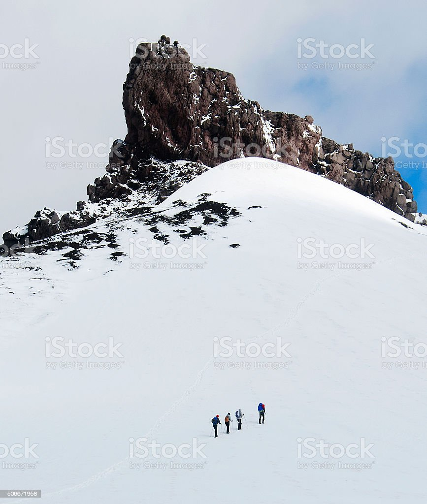 Group of climbers is on snow slope stock photo