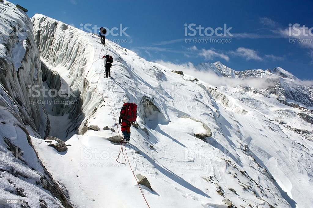 group of climbers on rope on glacier stock photo