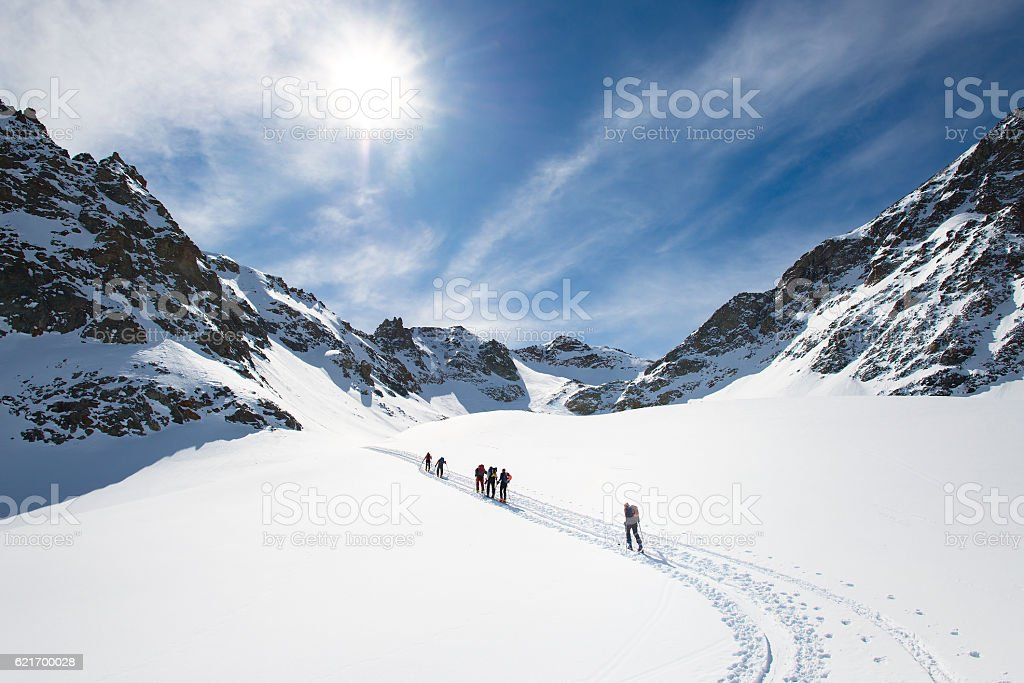 Group of climbers roped to the summit stock photo