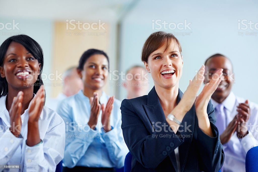 Group of colleagues applauding royalty-free stock photo