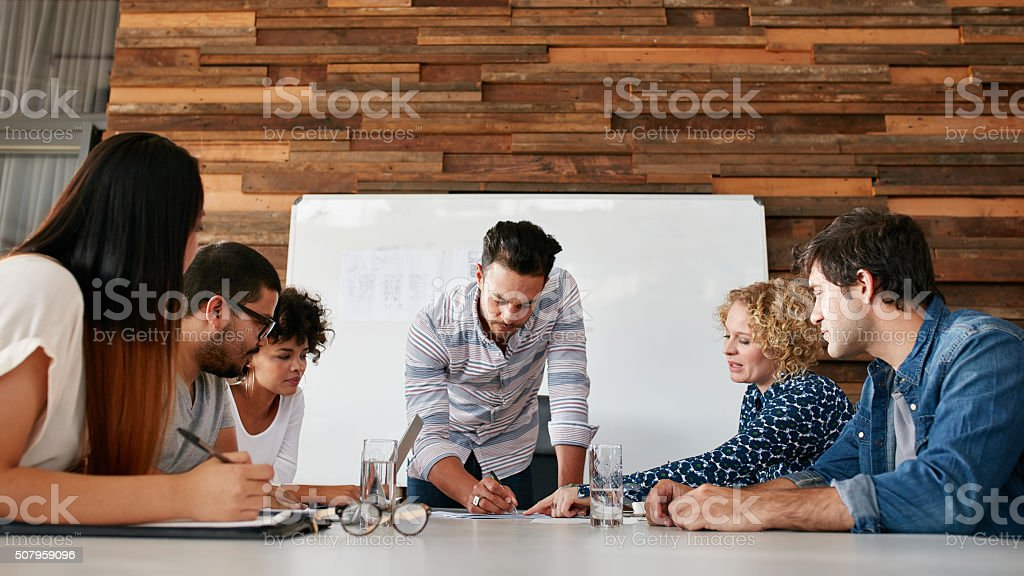 Group of colleagues having a brainstorming session stock photo