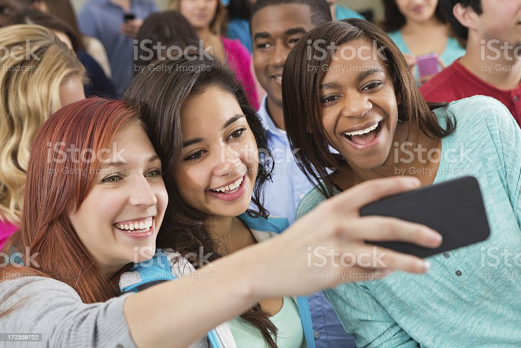 Group of college girls taking self photo during class/ seminar royalty-free stock photo