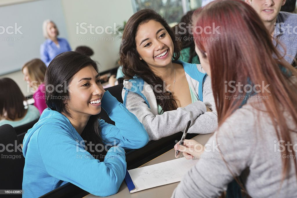 Group of college or high school students studying together royalty-free stock photo