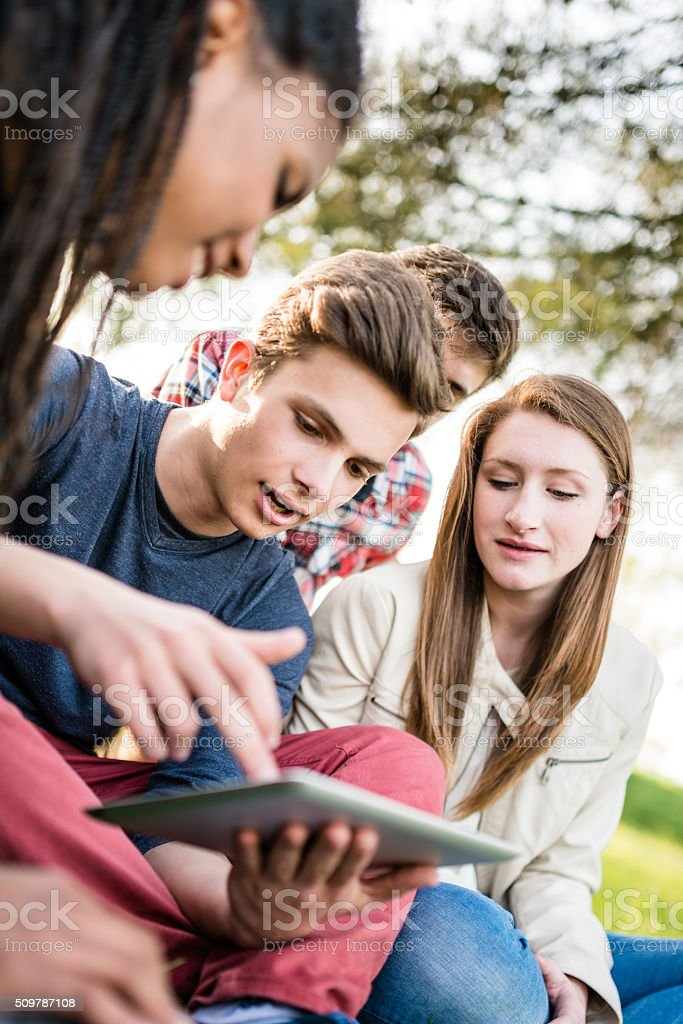 Group of college student laughing and studying togetherness stock photo