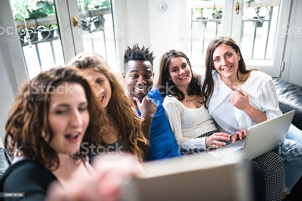 Group of college student take a selfie on the apartment stock photo