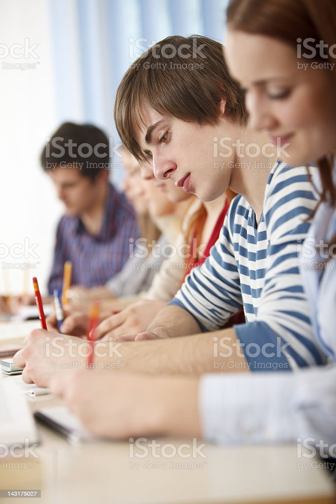 Group of college students doing an exam royalty-free stock photo